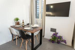 TV a/nebo společenská místnost v ubytování Testaccio historic house