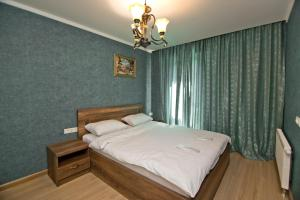 A bed or beds in a room at Orbi Bakuriani apartment 731