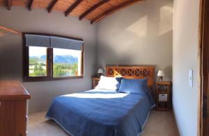 Una cama o camas en una habitación de Cerro catedral snow