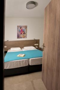 Voodi või voodid majutusasutuse Blue Horizon Apartments toas