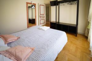 A bed or beds in a room at AC Via Garibaldi in Centro