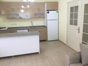 A kitchen or kitchenette at Yalova Apartments