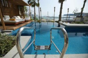 The swimming pool at or near Five Palm - 4 Bedroom Villa with Private Pool