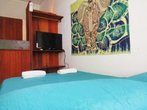 Een bed of bedden in een kamer bij Apartamentos Summer Staying