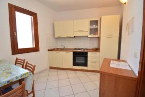 A kitchen or kitchenette at Citai con splendida vista mare