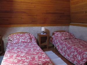 A bed or beds in a room at Holiday Home Le Pigeonnier