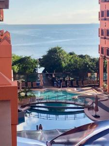 A view of the pool at Flat Partic Hotel Jurere Beach Village or nearby