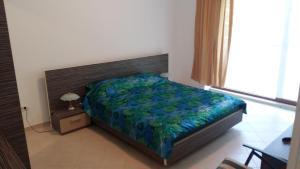 Un pat sau paturi într-o cameră la Club Residence Apartment