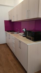 A kitchen or kitchenette at Diana Apartment