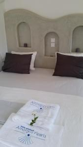 A bed or beds in a room at Amorgos Pearls