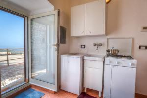 A kitchen or kitchenette at Casa Vacanze al Conservatore