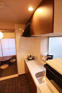 A kitchen or kitchenette at Sakura Stay Yoga 301