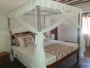 En eller flere senger på et rom på Palmetino villas B3- Malindi