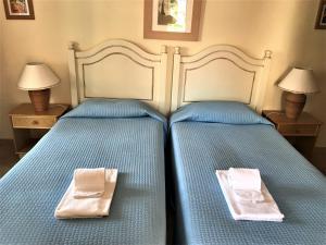En eller flere senge i et værelse på Old Village