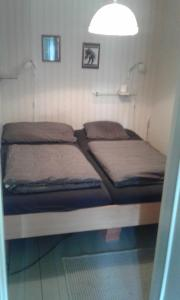 A bed or beds in a room at Holiday House in Lapland, Överkalix