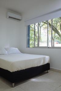 A bed or beds in a room at Apartamento Lleras
