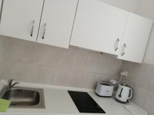 A kitchen or kitchenette at Apartments Sun & Sea