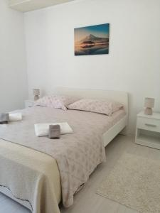 A bed or beds in a room at Apartments Sun & Sea