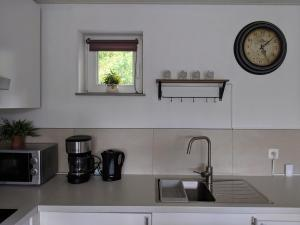 A kitchen or kitchenette at Terrasses de Malmedy H&H