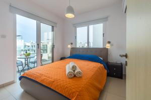 A bed or beds in a room at Nissini Villas 2