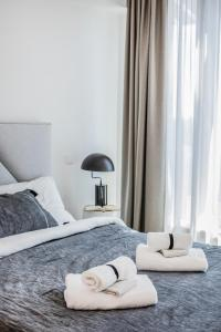 A bed or beds in a room at LUXURY & BRAND NEW APARTMENT, close to Tallinn Zoo