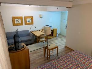 Uma área de estar em Apartio Oscar Freire
