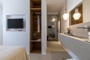 A kitchen or kitchenette at Studios Athina Plaka