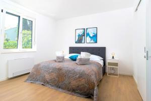 Postelja oz. postelje v sobi nastanitve Stunning Beach Apartments in Split