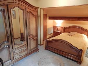 A bed or beds in a room at Holiday Home La Tour