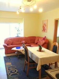 Ein Sitzbereich in der Unterkunft Comfort Apartments