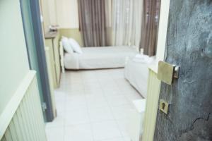 Ένα ή περισσότερα κρεβάτια σε δωμάτιο στο La Luna