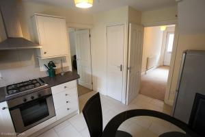 A kitchen or kitchenette at House by Five Ways Station and City Centre