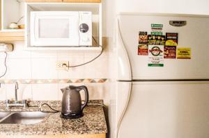 Una cocina o kitchenette en Complejo Granaderos