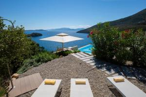 A view of the pool at Villa Kastos or nearby