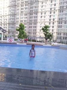 The swimming pool at or near Fernandez condo