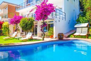The swimming pool at or near Villa Tarantino by Hello Apartments Sitges