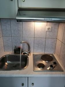 A kitchen or kitchenette at Agnanti Rooms