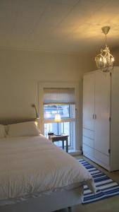 A bed or beds in a room at Vita Huset Extended Stay