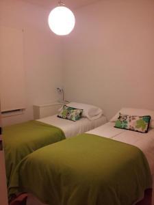 Una cama o camas en una habitación de La Casa de la Ruda