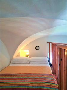 A bed or beds in a room at Florenza Residence