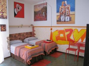 A bed or beds in a room at ¡Cozy!