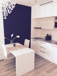 A bathroom at Apartement Blanc de luxe