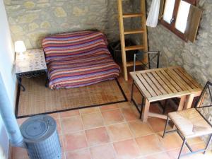 Cama o camas de una habitación en Casa de Piedra frente al Congost de Mont-Rebei