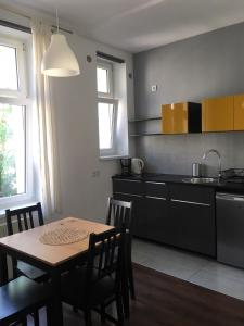 A kitchen or kitchenette at Apartament Cracow