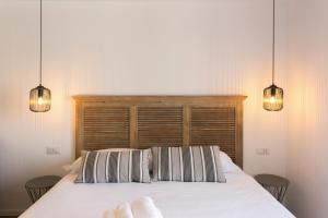 Letto o letti in una camera di Milano Apartments Porta Genova