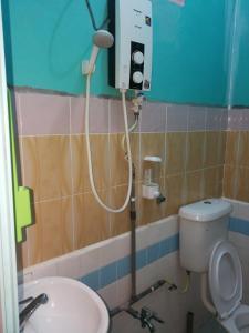 Ein Badezimmer in der Unterkunft Rainbow Chalet