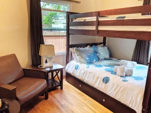 A bunk bed or bunk beds in a room at Once Upon a Tide Beach House