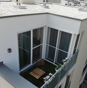 Ein Balkon oder eine Terrasse in der Unterkunft VIC & UNO City Charming Apart Plus Garage