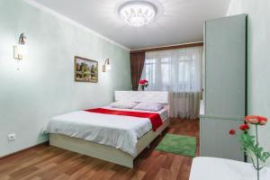 Кровать или кровати в номере Ростов Стачки