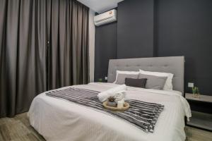 A bed or beds in a room at Octagon Ipoh by Plush